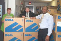 Photo 1: Ohio State Office IT Specialist Marie Powers and Community Builder Randolph Wilson assist Jeffrey Marshall, Administrator with final inventory of computers for the school