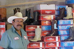 [Photo 2: Mr. Salazar's in his store]