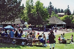 [Photo 1:  4,000 local residents at Spokane's Liberty Park]