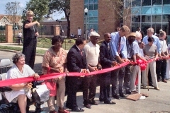 [Photo 1: Ribbon cutting ceremony for the new townhomes at Carver Park]