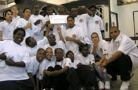 [Photo 1: Black Contractors Association of San Diego Youthbuild participants with their $700,000 check from HUD.]