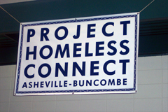 [Photo 1: Project Homeless Connects sign]
