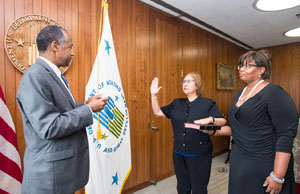 [HUD Secretary Ben Carson delivering the oath of office to Anna Maria Farías with former FHEO Assistant Secretary Kim Kendrick (holding the bible)]