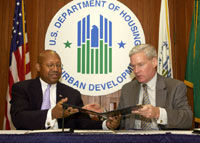 [Photo: Commissioner Mark W. Everson and HUD Secretary Alphonso Jackson signing partnership agreement]