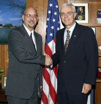 [Photo 2: Tim Oravec and Roy A. Bernardi shaking hands]