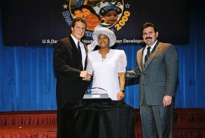 Photo of Mayor Eilma Davis receiving Best of the Best award