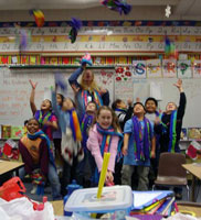 Mountain View Elementary Students throwing their hats