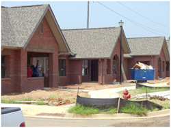[Photo: New construction funded with ARRA funds is making a difference in Tuscaloosa, Alabama. These are three of 144 units under construction in the McKenzie Court Community.]
