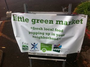 [Photo 2: Sign promoting pop-up farmers market]