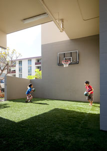 [Photo 3: Kids play in a transformed a loading zone to gathering/recreation space.]