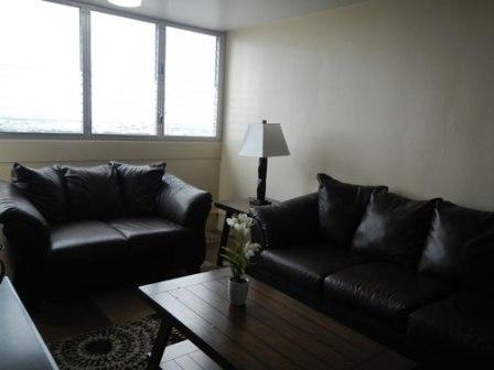 [Photo 3: Living room of model apartment available at the newly renovated Towers at Kuhio Park.]