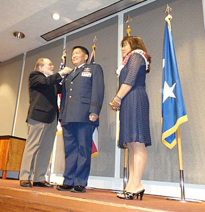 [Photo 2: Hawaii Governor Neil Abercrombie and Mrs. Mindy Okahara pin on the stars at the official promotion ceremony for Brigadier General Okahara.]
