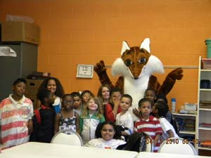 [Photo: Franklin the Fair Housing Fox visits children in Cedar Rapids, Iowa to teach them about fair housing]