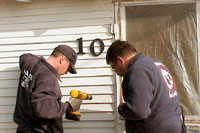 [Photo 3: In addition to smoke detectors, firefighters also installed address numbers on 246 homes.]