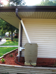 [Photo 1: Rain barrels installed at Morehead Housing Authority save both money and the environment.]