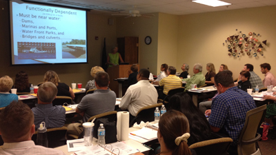 [Photo: Sandra Frye presents environmental training]