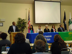 [Photo: HUD Kentucky Field Office Director Christopher Taylor encourages attendees to access the agency of opportunity (HUD) to aid the Hispanic community]