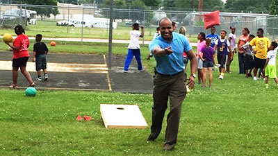 [Photo: HUD Kentucky Field Office Director Christopher Taylor spends quality time with the youth from the Bowling Green Learning Center for the Dads for a Day Friends for Life housing authority Father's Day event]