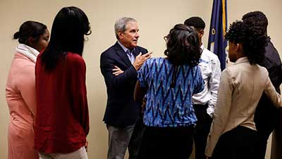 [Photo 2: Congressman Yarmuth speaks with the students after the session and answers their many questions.]
