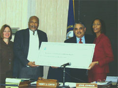[Photo: Executive Director John Johnson of the Kentucky Human Rights Commission Receiving a Grant]
