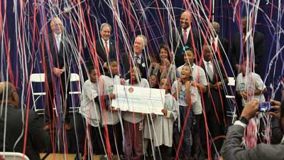 [Photo: Confetti falls as happy Russell neighborhood children join local leaders and HUD celebrate in the nearly $30 million Choice Neighborhood Grant Announcement that will positively impact their neighborhood]