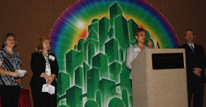 [Photo 1: 2013 SAHMA Conference: Susan Westbrook, NCHFA; Amy Vorenkamp, NC Quadel; Dottie Troxler, HUD NC and SC Multifamily Hub Director (addressing conference attendees); and George Caruso, President of SAHMA]