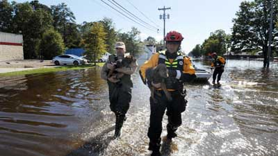 [Photo: Flooding caused by Hurricane Matthew]