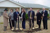 [Photo:  Officials and Barbara Fox planting a tree]