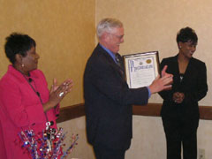 [Photo 1: Field Office Director Del Reynolds receiving a Proclamation proclaiming Wednesday, May 6, 2009]